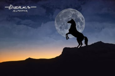 Horse rearing up under a full moon