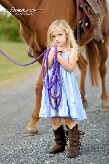 Cute little girl with horse portrait