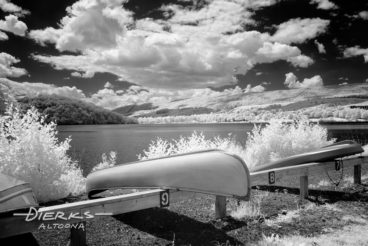 Canoe at summer lake in black and white infrared