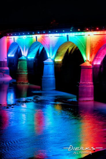 Bridge at Johnstown PA iluminated at night in rainbow colors.