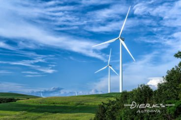 Wind turbine against a beautiful summer landscape in Pennsylvania creating renewable green energy.