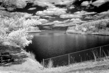 A landscape with lake in Spring Pennsylvania scenery, a photo in black and white infrared.