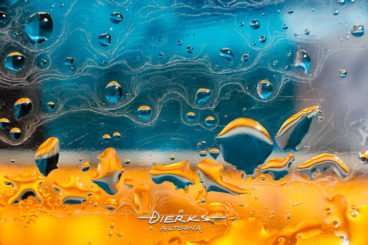 A vivid and colorful liquid photo abstract in blue and yellow shot using micro photography.