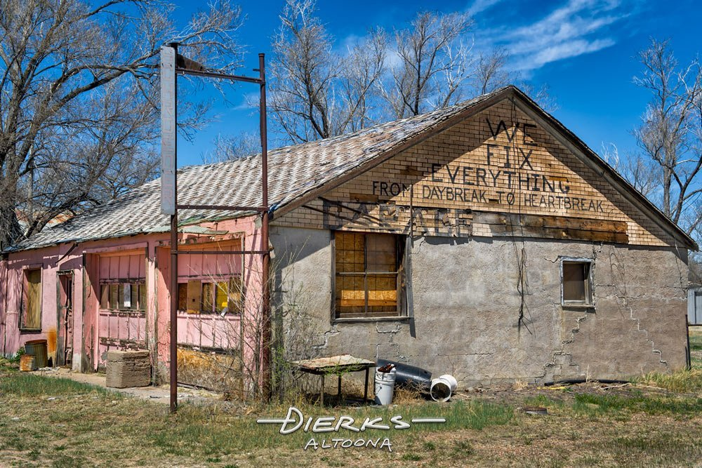 A handyman's repair shop and fix it garage sitting abandoned on the plains of Colorado.