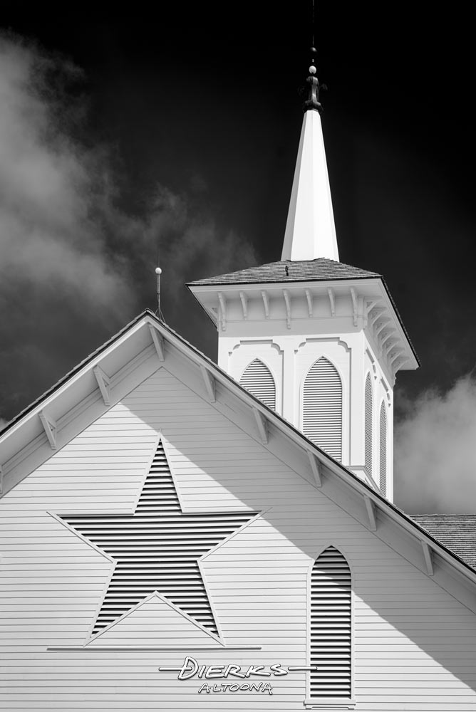 The Star Barn steeple and star in a back and white close-up taken with infrared photography.
