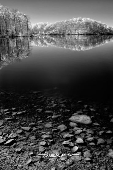 A lake landscape done in black and white infrared photography.