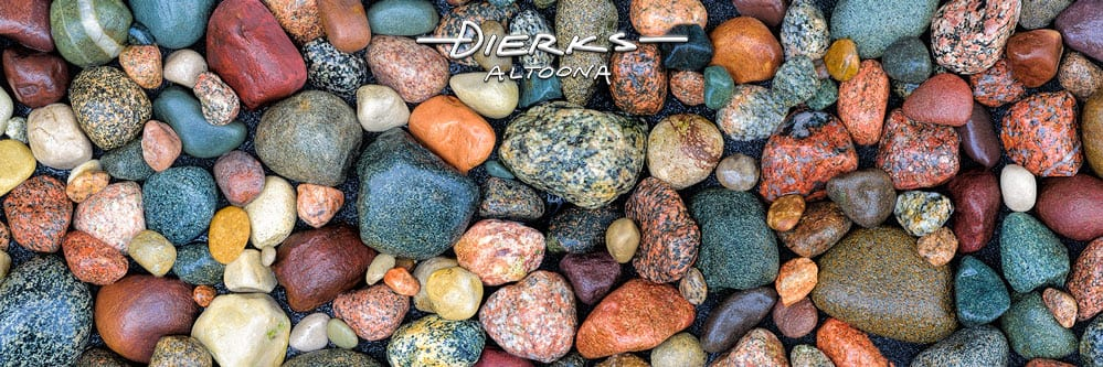Rock art as a panorama of granite and sandstone from Lake Michigan with a good luck ring rock..
