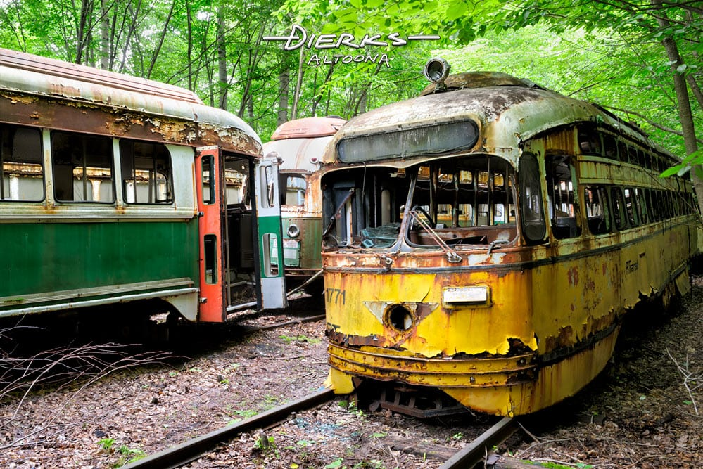 Old trolley in a wooded streetcar graveyard, a PCC car from PAT Transit in Pittsburgh.
