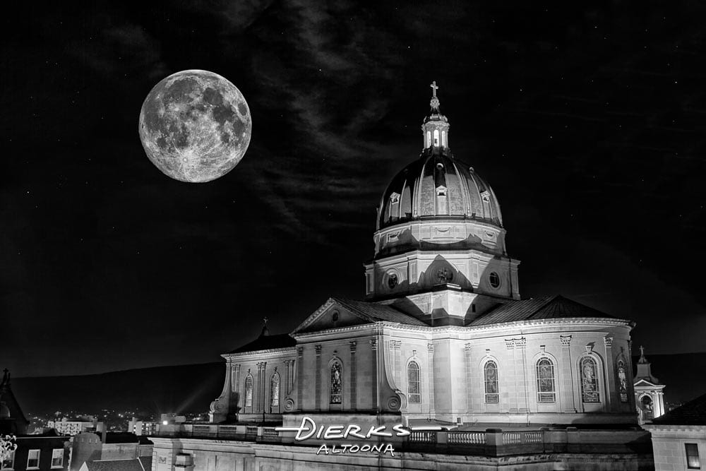 Altoona Cathedral at night under a full moon in black and white photography.