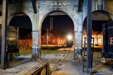 At the fall of night, an East Broad Top steam locomotive heads into its roundhouse berth at the end of day in Orbisonia, PA.
