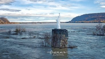A Statue of Liberty replica on an old bridge pier in the Susquehanna River near Harrisburg, Pennsylvania, here looking downriver.