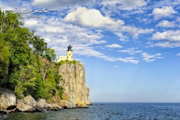 Split Rock Lighthouse high on a rock bluff above the Lake Superior coastline in Minnesota.