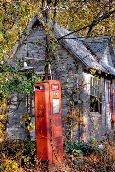 An old country gas station in the Pennsylvania outback with a retired Atlantic gas pump in red.