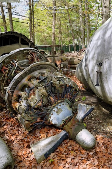 Ever have one of those days? As an example, an airplane engine with broken props lying in a wooded junkyard.with broken props lying in a wooded junkyard.