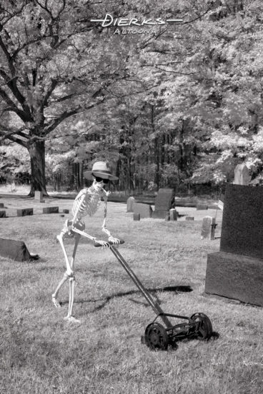 A skeleton caretaker cutting grass in a cemetery, mowing while smoking his pipe.