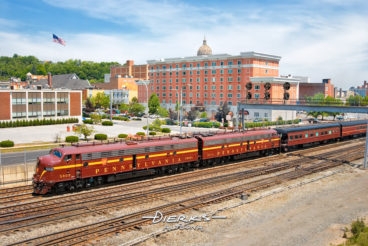 Restored PRR E8 diesel locomotives from 1952 just leaving the downtown train station in Altoona PA with a railfan excursion.