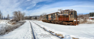 A panorama of a GG1 electric railroad locomotive sitting abandoned in winter snow and deep cold, former PRR #4917, Penn Central #4934.