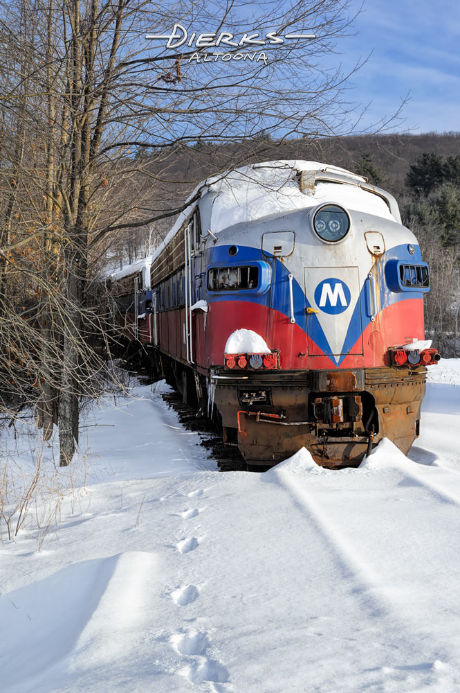 It doesn't come any colder or more dead than these two Metro North FL-9s. These old railroad locomotives rest capped in snow like some kind of junkyard Everest in central New York.