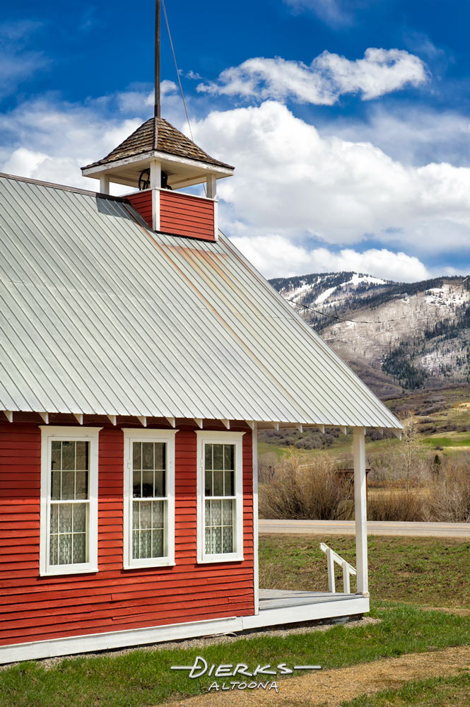A restored one-room schoolhouse from years ago on a sunny Spring day in the Rock Mountains, Mesa Schoolhouse outside Steamboat Springs, Colorado.