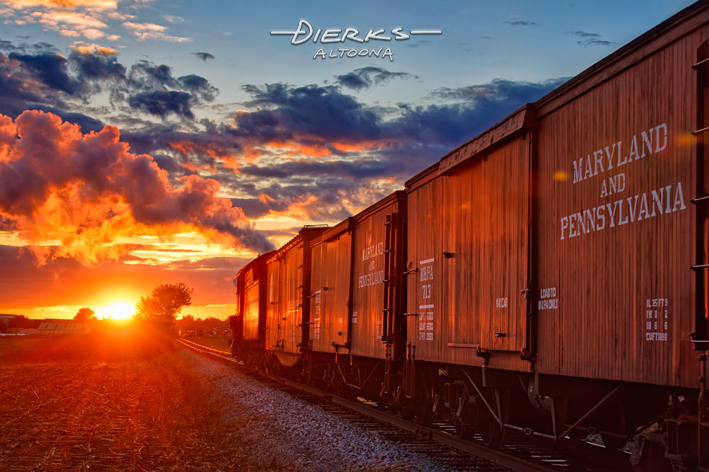 A steam freight train heading into the low red sunset and home. Strasburg Railroad, Lancaster County, Pennsylvania.