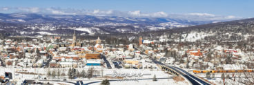 A scenic panoramic view of Hollidaysburg PA from Chimney Rocks overlook in winter snow and sunshine.